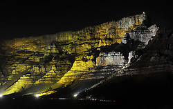 South Africa - Cape Town - 6 October 2020 - The iconic Table Mountain was light up in gold on Tuesday, October 6 for the fighters, survivors and those who have passed away from childhood cancer.<br /> Gold is the colour of choice because the international awareness symbol for Childhood Cancer is the gold ribbon. This ribbon symbolises all forms of cancer affecting children and adolescents, unlike other ribbons, which focus on one particular cancer.<br /> According to the Cancer Association of South Africa (CANSA), the five most prevalent childhood cancers in South Africa are:<br /> – Leukaemia<br /> – Lymphoma (tumours that begin in the lymph glands)<br /> – Brain tumours<br /> – Nephroblastomas or Wilms tumours – cancer of the kidneys<br /> – Soft tissue sarcomas (tumours that begin in the connective tissue)<br /> CANSA has been spearheading the fight against cancer in South Africa since 1931. The purpose of the organisation has been to offer the public an integrated and unique service to all who have been affected by cancer. Photographer: Armand Hough/African News Agency(ANA)
