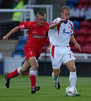 Photo: Daniel Hambury.Digitalsport<br /> Rushden & Diamonds v Swindon Town.  24/8/2004<br /> The Carling Cup<br /> <br /> Swindon Town's Alan Reeves and Rushden & Diamonds'Alex Hay