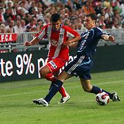 NLD/Amsterdam/20070802 - LG Amsterdams Tournament 2007, Ajax - Atletico Madrid, Giorgios Seitaridis in duel met Thomas Vermaelen