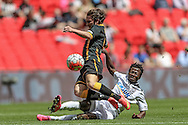Luke Carr (Morpeth Town) is tackled by Sirdic Grant (Hereford FC) during the FA Vase match between Hereford and Morpeth Town at Wembley Stadium, London, England on 22 May 2016. Photo by Mark Doherty.