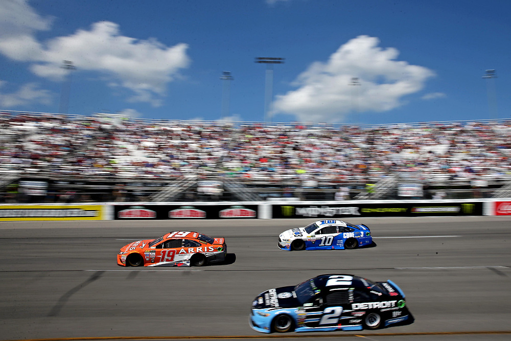 Apr 30, 2017; Richmond, VA, USA; NASCAR Cup Series driver Daniel Suarez (19), NASCAR Cup Series driver Danica Patrick (10) and NASCAR Cup Series driver Brad Keselowski (2) during the Toyota Owners 400 at Richmond International Raceway. Mandatory Credit: Peter Casey-USA TODAY Sports