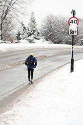 Jogger takes to the road on the A6135 Ecclesfield Rd, Chapeltown Sheffield,  during the most widespread Snows to hit Britain for 20 years.1st December 2010.Images © Paul David Drabble