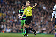 Referee Michael Jones looks on. Barclays Premier league match, Tottenham Hotspur v Swansea city at White Hart Lane in London on Sunday 28th February 2016.<br /> pic by John Patrick Fletcher, Andrew Orchard sports photography.