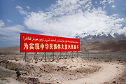 Xinjiang, China. «Aim for the great rejuvenation of the Chinese nation», one of many billboards along the main roads of the province. To develop the region closer to the national standards, the state encourages Hans to settle in the province with propaganda, but also with financial incentives. NATACHA DE MAHIEU