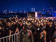 05 DECEMBER 2016 - BANGKOK, THAILAND: People wait for a ceremony honoring the late king to start on Bhumibol Bridge. Tens of thousands of Thais gathered on Bhumibol Bridge in Bangkok Monday to mourn the death of Bhumibol Adulyadej, the Late King of Thailand. The King died on Oct 13 after a lengthy hospitalization. December 5 is his birthday and a national holiday in Thailand. The bridge is named after the late King, who authorized its construction. 999 Buddhist monks participated in a special merit making ceremony on the bridge.       PHOTO BY JACK KURTZ