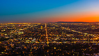 High angle skyline view looking west over Los Angeles, California USA at twilight,