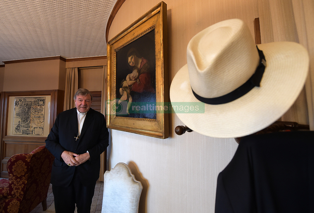 File photo - Australian Cardinal George Pell poses at his office in the San Giovanni Tower at the Vatican on October16, 2014. Cardinal George Pell has been found guilty of sexual offences in Australia, making him the highest-ranking Catholic figure to receive such a conviction. Pell abused two choir boys in the rooms of a Melbourne cathedral in 1996, a jury found. He had pleaded not guilty. The verdict was handed down in December, but it could not be reported until now due to legal reasons. Pell is due to face sentencing hearings from Wednesday. He has lodged an appeal against his conviction.. Photo by Eric Vandeville /ABACAPRESS.COM