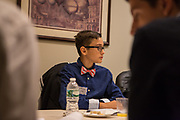 Purchase, NY – 31 October 2014. Yonkers High School student Anthony Doqaj conferring with his teammates. The Business Skills Olympics was founded by the African American Men of Westchester, is sponsored and facilitated by Morgan Stanley, and is open to high school teams in Westchester County.