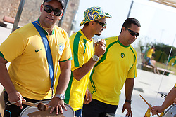 Brazilain supporters dressed up for the World Cup football match between Brazil and Portugal. Portimao Portugal Match Cup 2010. World Match Racing Tour. Portimao, Portugal. 25 June 2010. Photo: Gareth Cooke/Subzero Images