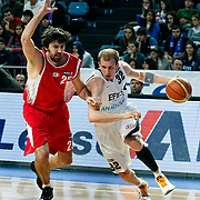 Efes Pilsen's Sinan GULER (R) and Erdemir's Erkan VEYSELOGLU (L) during their Turkish Basketball league match Efes Pilsen between Erdemir at the Sinan Erdem  Arena in Istanbul Turkey on Saturday 29 January 2011. Photo by TURKPIX