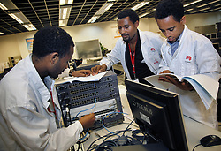 Sept. 15, 2011 - Shenzhen, CHN - Engineers from the Addis Ababa Information & Communication Technology Development Agency  (AAICTDA) in Ethiopia, Africa, train on Huawei's networking equipment at the training center at Huawei headquarters in Shenzhen, China, September 15, 2011. (Credit Image: © Lipo Ching/San Jose Mercury News/TNS/ZUMAPRESS.com)