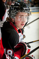 KELOWNA, CANADA - OCTOBER 18:  Jake Mykitiuk #18 of the Prince George Cougars stands on the bench as the Prince George Cougars visit the Kelowna Rockets on October 18, 2012 at Prospera Place in Kelowna, British Columbia, Canada (Photo by Marissa Baecker/Shoot the Breeze) *** Local Caption ***