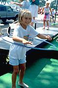 8 year old child Hula Hooping at Minnesota State Fair.  St Paul  Minnesota USA