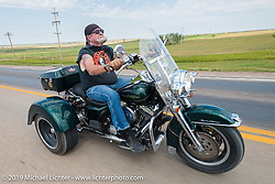 Dean Shawler (past editor of Biker Magazine) rides his Harley-Davidson trike back to Sturgis on the annual Michael Lichter - Sugar Bear Ride hosted by Jay Allen from the Easyriders Saloon during the Sturgis Black Hills Motorcycle Rally. SD, USA. Sunday, August 3, 2014. Photography ©2014 Michael Lichter.