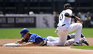 CHICAGO - JULY 06:  Chris Getz #17 of the Kansas City Royals steals second base against the Chicago White Sox on July 6, 2011 at U.S. Cellular Field in Chicago, Illinois.  The Royals defeated the White Sox 4-1.  (Photo by Ron Vesely/MLB Photos via Getty Images)  *** Local Caption *** Chris Getz