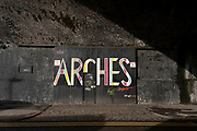 Door to the Arches project space in the old industrial area and railway arches of Digbeth on 14th December 2020 in Birmingham, United Kingdom. Following the destruction of the Inner Ring Road, Digbeth is now considered a district within Birmingham City Centre, and is the epicentre for arts and graffiti artworks as well as its status as a once-gritty bohemian district known for street art and a young and hip people attending events and creative workshops at the Custard Factory and grungy clubs in former warehouses. As part of the Big City Plan, Digbeth is undergoing a large redevelopment scheme that will regenerate the old industrial buildings into apartments, retail premises, offices and arts facilities. There is still however much industrial activity in the south of the area.