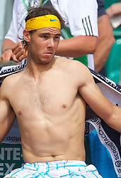 MONTE-CARLO, MONACO - Saturday, April 17, 2010: Rafael Nadal (ESP) changes his shirt during the Men's Singles Semi-Final on day six of the ATP Masters Series Monte-Carlo at the Monte-Carlo Country Club. (Photo by David Rawcliffe/Propaganda)