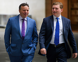 © Licensed to London News Pictures. FILE PICTURE DATED: 10/07/2016. London, UK. UKIP donor ARRON BANKS (left) arrives at the BBC Broadcasting House in London with former aide to Nigel Farage, GEORGE COTTRELL (right) before appearing on the Andrew Marr Show on July 10, 2016. COTTRELL is facing up to 20 years in jail in the US after admitting to fraud. Photo credit: Ben Cawthra/LNP