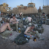 A convoy of Warthog and Jackal armored fighting vehicles form a defensive perimeter for British soldiers of 16 Air Assault Bde's elite BRF (Brigade Reconnaissance Force) as they prepare to spend the night sleeping in the desert after an operation in the village of Kakaran in Helmand Province, Southern Afghanistan on the 14th of March 2011.