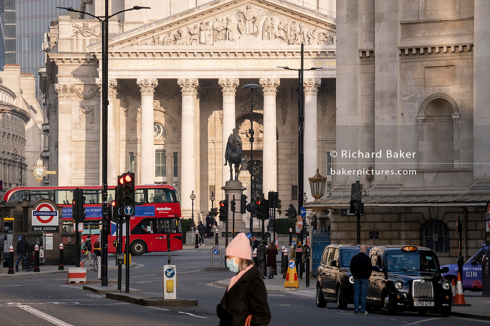 Days before the Chancellor Rishi Sunak delivers his Budget, little traffic or pedestrians pass through a quiet Queen Victoria Street during the third lockdown of the coronavirus pandemic, in the City of London, the capital's financial district, on 1st march 2021, in London, England.
