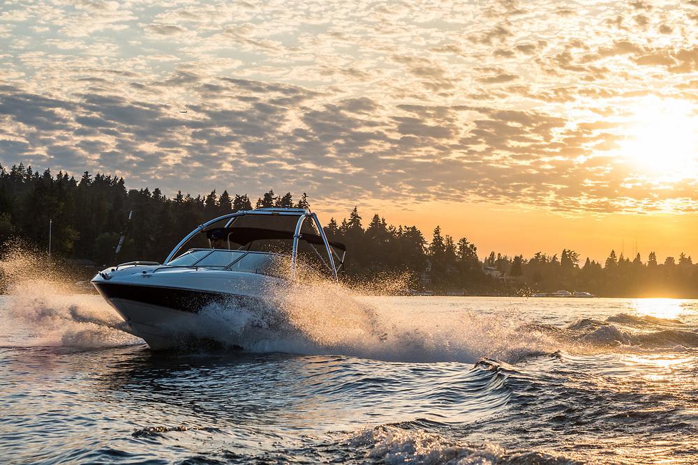 United States, Washington, Bellevue. Motor boat in sunset on Lake Washington.