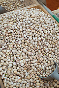 Pistachio nuts with scoop on display for sale on market stall at old street market - Mercado -  in Ortigia, Syracuse, Sicily