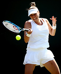 Vera Zvonareva in action against Angelique Kerber on day two of the Wimbledon Championships at the All England Lawn Tennis and Croquet Club, Wimbledon. PRESS ASSOCIATION Photo. Picture date: Tuesday July 3, 2018. See PA story TENNIS Wimbledon. Photo credit should read: John Walton/PA Wire. RESTRICTIONS: Editorial use only. No commercial use without prior written consent of the AELTC. Still image use only - no moving images to emulate broadcast. No superimposing or removal of sponsor/ad logos. Call +44 (0)1158 447447 for further information.
