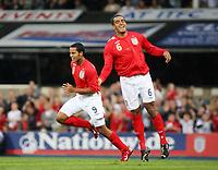 Photo: Chris Ratcliffe.<br /> England U21 v Moldova U21. European Championship Qualifier. 15/08/2006.<br /> Theo Walcott of England U21 celebrates his goal with Tom Huddlestone (R).