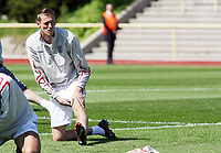 Photo: Chris Ratcliffe.<br />England training session. 07/06/2006.<br />Peter Crouch warms up in training.