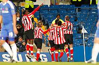 Football - Premier League - Chelsea vs. Sunderland<br /> <br /> Sunderland's Asamoah Gyan runs to the away fans after scoring sunderland's second goal at Stamford Bridge