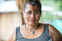 16 November 2018, San José de León, Mutatá, Antioquia, Colombia: Luz Alcira is part of both the gender and the health committees of the community in San José de León. Following the 2016 peace treaty between FARC and the Colombian government, a group of ex-combatant families have purchased and now cultivate 36 hectares of land in the territory of San José de León, municipality of Mutatá in Antioquia, Colombia. A group of 27 families first purchased the lot of land in San José de León, moving in from nearby Córdoba to settle alongside the 50-or-so families of farmers already living in the area. Today, 50 ex-combatant families live in the emerging community, which hosts a small restaurant, various committees for community organization and development, and which cultivates the land through agriculture, poultry and fish farming. Though the community has come a long way, many challenges remain on the way towards peace and reconciliation. The two-year-old community, which does not yet have a name of its own, is located in the territory of San José de León in Urabá, northwest Colombia, a strategically important corridor for trade into Central America, with resulting drug trafficking and arms trade still keeping armed groups active in the area. Many ex-combatants face trauma and insecurity, and a lack of fulfilment by the Colombian government in transition of land ownership to FARC members makes the situation delicate. Through the project De la Guerra a la Paz ('From War to Peace'), the Evangelical Lutheran Church of Colombia accompanies three communities in the Antioquia region, offering support both to ex-combatants and to the communities they now live alongside, as they reintegrate into society. Supporting a total of more than 300 families, the project seeks to alleviate the risk of re-victimization, or relapse into violent conflict.