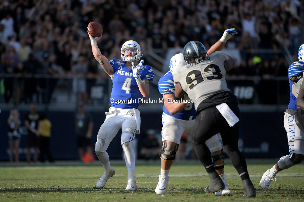 Memphis quarterback Riley Ferguson (4) throws a pass in front of Central Florida defensive lineman Tony Guerad (93) during the second half of the American Athletic Conference championship NCAA college football game Saturday, Dec. 2, 2017, in Orlando, Fla. Central Florida won 62-55. (Photo by Phelan M. Ebenhack)