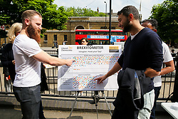 © Licensed to London News Pictures. 18/05/2019. London, UK. Men takes part in the Liberal Democrats Brexitometer by choosing their preferred option during the Liberal Democrats campaign in Islington, north London for the forthcoming European Parliament election. Photo credit: Dinendra Haria/LNP