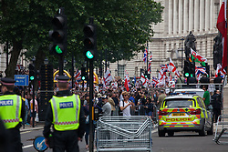 London, UK. 9th June, 2018. Supporters of Tommy Robinson, former leader of the far-right English Defence League, take part in the March for Tommy Robinson outside Downing Street.