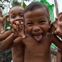 Kids making faces near Mab's house in Phon Bontheay Yomreach.