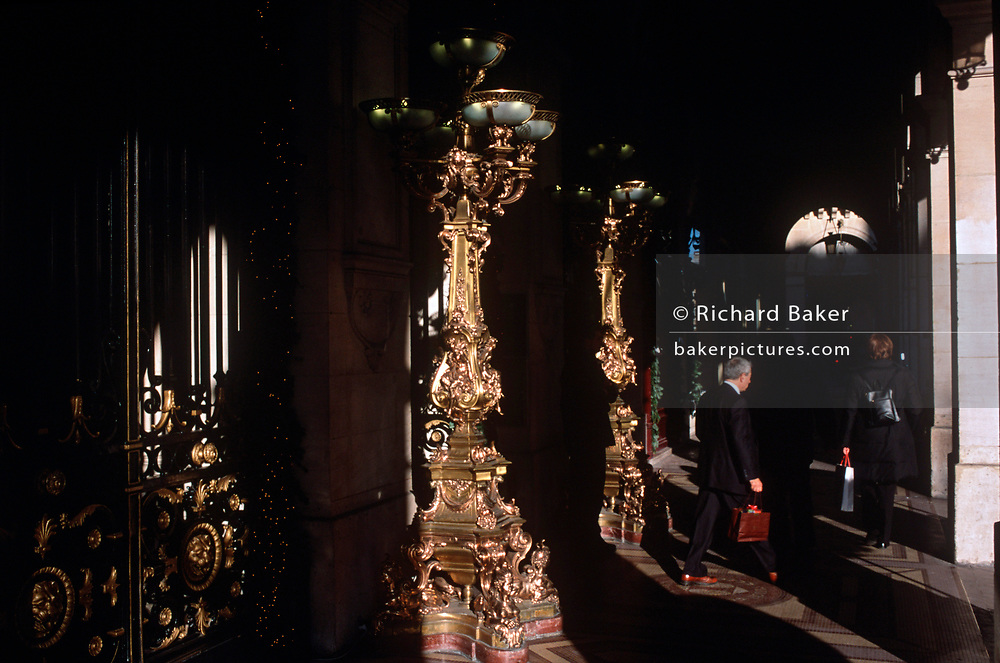 Oversized, golden candelabras in an arcade on the Rue de Rivoli, in the 1st Arrondissement, on 26th April 2008, in Paris France. (Photo by Richard Baker / In Pictures via Getty Images)