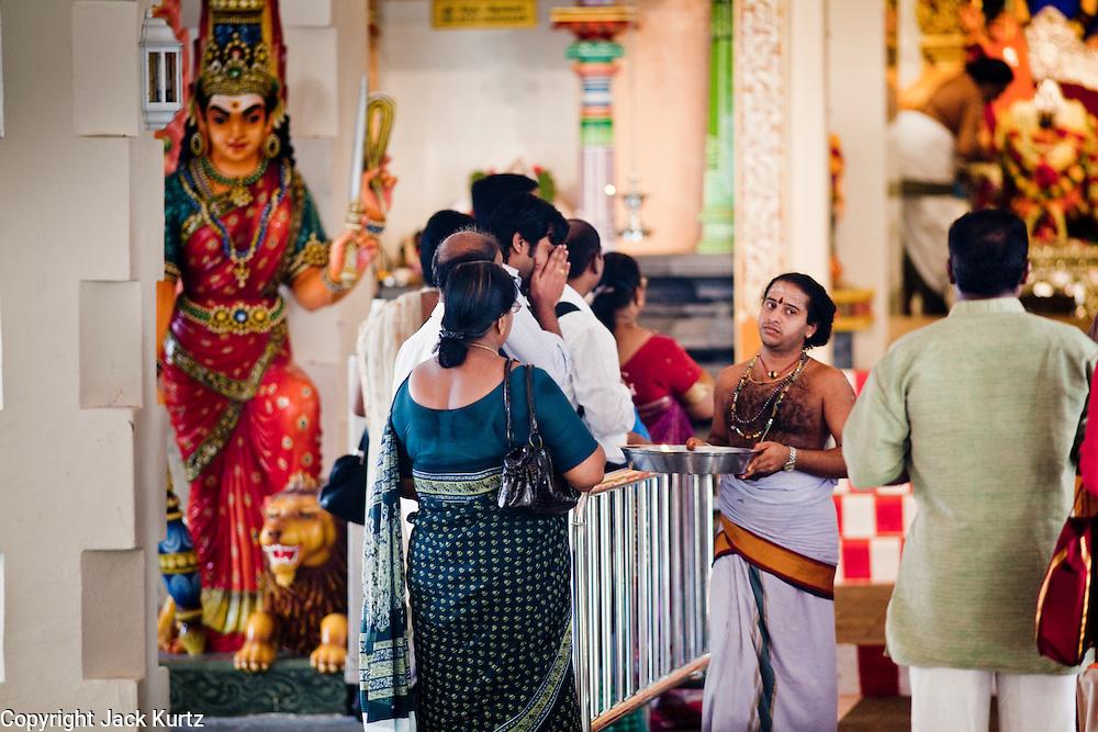 Apr. 28 -- SINGAPORE:  Hindus in the Sri Mariamman Hindu Temple in Singapore. It's the oldest Hindu temple in Singapore.     PHOTO BY JACK KURTZ