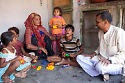 10-year-old Meena who is deafblind explores the sense of touch with her building blocks with the help of her family. She lives in the remote district of Surandrenagar, a 3-hour drive from Ahmadabad.  Meena is supported by Sense International in Ahmadabad, India.