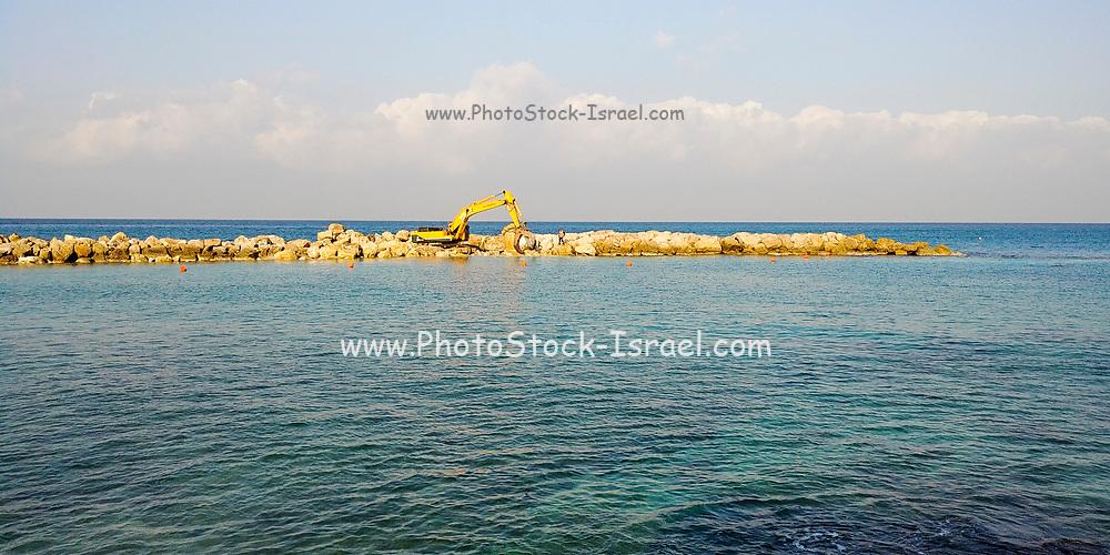 Building a breakwater in the Mediterranean Sea. Photographed in Bat Galim, Haifa, Israel