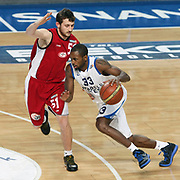 Anadolu Efes's Oliver Lafayette (R) and Erdemir's C.Alper Ozcan (L) during their Turkish Basketball League match Anadolu Efes between Erdemir at Arena in Istanbul, Turkey, Wednesday, January 28, 2012. Photo by TURKPIX