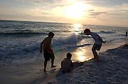 Young boys play at the beach in San Destin, Florida.