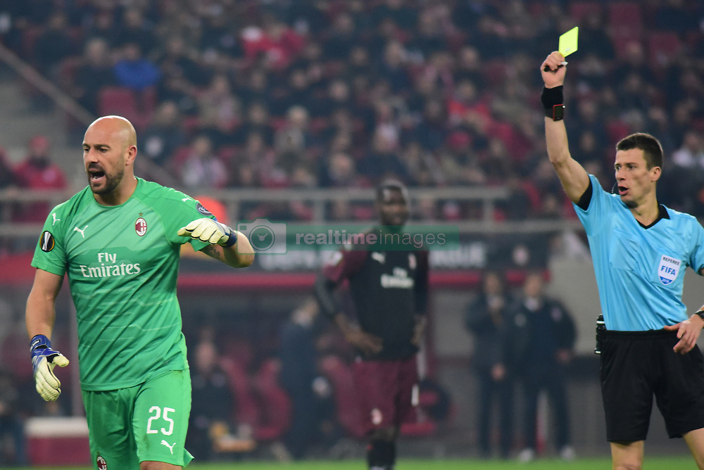 December 13, 2018 - Piraeus, Attiki, Greece - Referee Benoit Bastien is showing yellow card to Pege Reina (no 25) goalkeeper of Milan. (Credit Image: © Dimitrios Karvountzis/Pacific Press via ZUMA Wire)