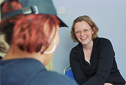 Discussion between drug advice worker and client,