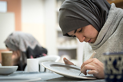 25 February 2020, Jerusalem: Student Jawaher Gaith works on a design in ceramics class. The Lutheran World Federation's vocational training centre in Beit Hanina offers vocational training for Palestinian youth across a range of different professions, providing them with the tools needed to improve their chances of finding work.
