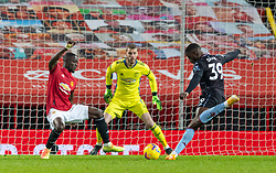MANCHESTER, ENGLAND - Friday, January 1, 2020: Manchester United's Eric Bailly blocks an injury time shot from Aston Villa's Keinan Davis during the New Year's Day FA Premier League match between Manchester United FC and Aston Villa FC at Old Trafford. The game was played behind closed doors due to the UK government putting Greater Manchester in Tier 4: Stay at Home during the Coronavirus COVID-19 Pandemic. (Pic by David Rawcliffe/Propaganda)