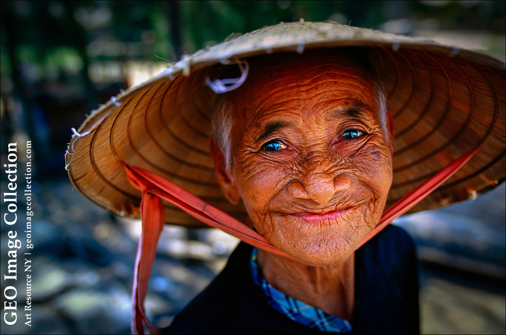 Despite living through years of hardship under the French, the Americans and their Vietnamese allies, and, more recently, conflicts with China, a vendor in a market in the coastal city of Hoi An has a ready smile for customers.  She wears a nón lá--a conical hatmade of palm leaf and worn by Vietnamese of all ages and both genders.