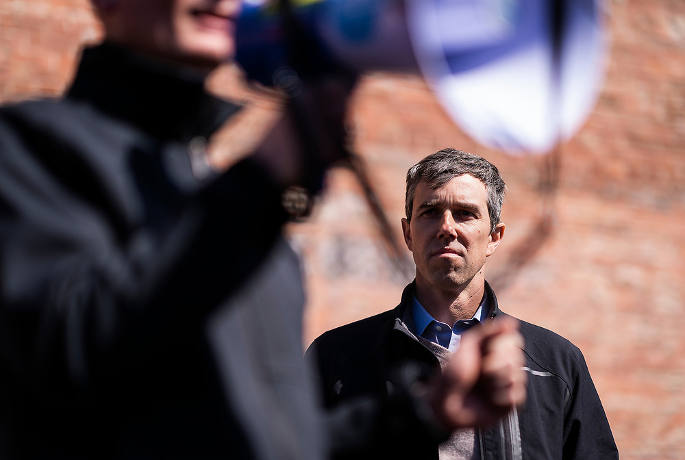 Democratic 2020 presidential candidate Beto O'Rourke, 46, looks on as Democratic State Senate candidate Eric Giddens speaks during O'Rourke's three day road trip across Iowa, in Waterloo, Iowa, U.S., March 16, 2019.  REUTERS/Ben Brewer