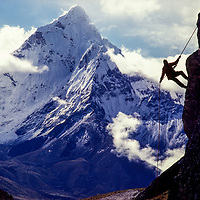 Pertemba Sherpa demonstrates  rappelling  at an early mountaineering school for sherpas in the Khumbu region of Nepal, 1980. Mt. Ama Dablam bkg.