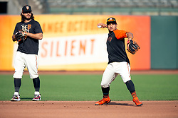 Oct 7, 2021; San Francisco, CA, USA; San Francisco Giants infielder Brandon Crawford, left, and teammate Donovan Solano take grounders at shortstop during NLDS workouts. Mandatory Credit: D. Ross Cameron-USA TODAY Sports
