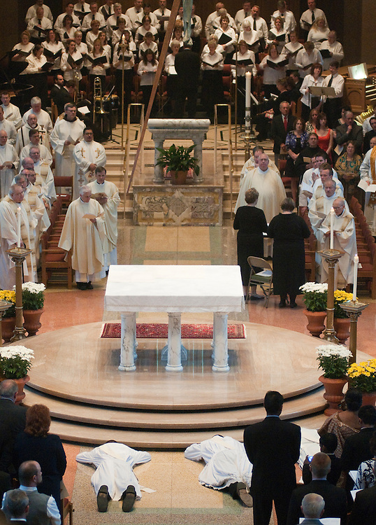 Candidates lay before the altar during the litany of saints.